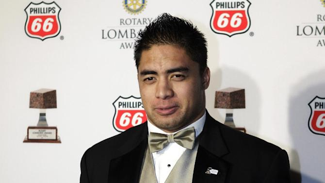 Notre Dame linebacker Manti Te'o poses with the Lombardi Award after a ceremony, Wednesday, Dec. 5, 2012, in Houston. Te'o, also a Heisman Trophy finalist, had 103 tackles and seven interceptions this year to help the undefeated Fighting Irish reach the BCS championship game against Alabama. (AP Photo/Houston Chronicle, Melissa Phillip)