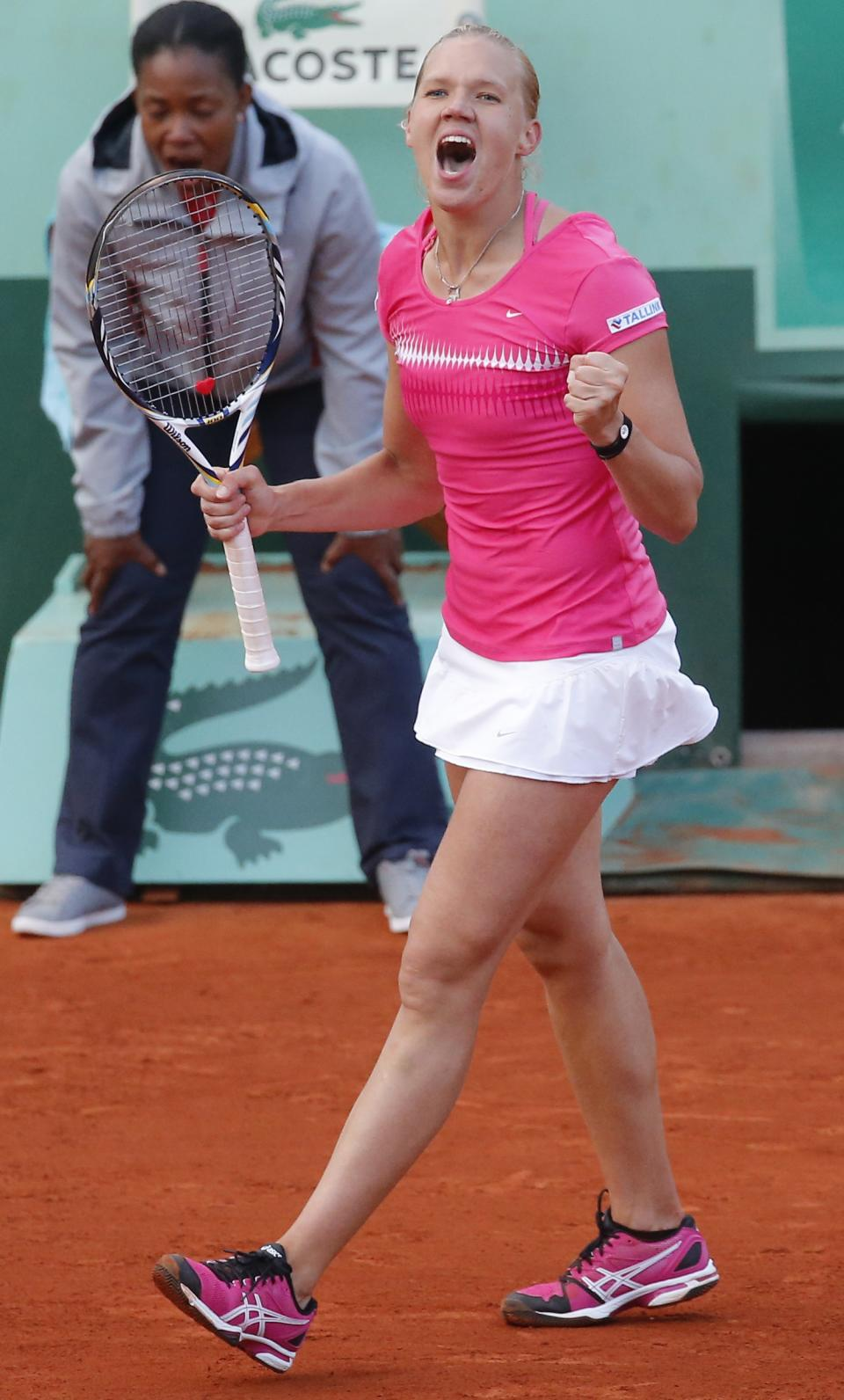 Estonia's Kaia Kanepi reacts as she defats The Netherlands' Arantxa Rus during their fourth round match in the French Open tennis tournament at the Roland Garros stadium in Paris, Monday, June 4, 2012. (AP Photo/Michel Euler)