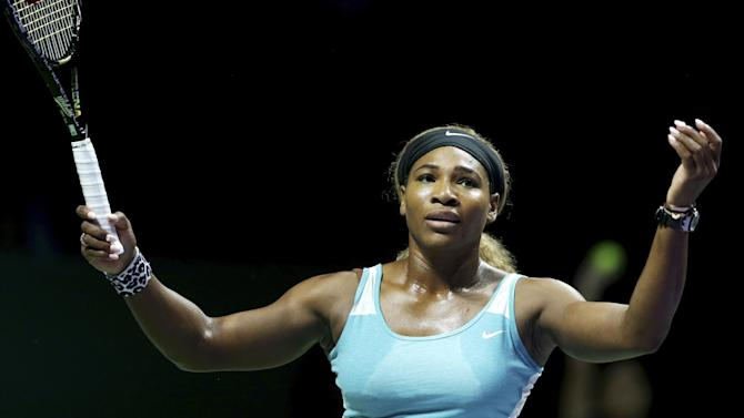 Serena Williams of the U.S. reacts during her singles match against Romania's Simona Halep at the WTA tennis finals in Singapore, Wednesday, Oct. 22, 2014. (AP Photo/Mark Baker)