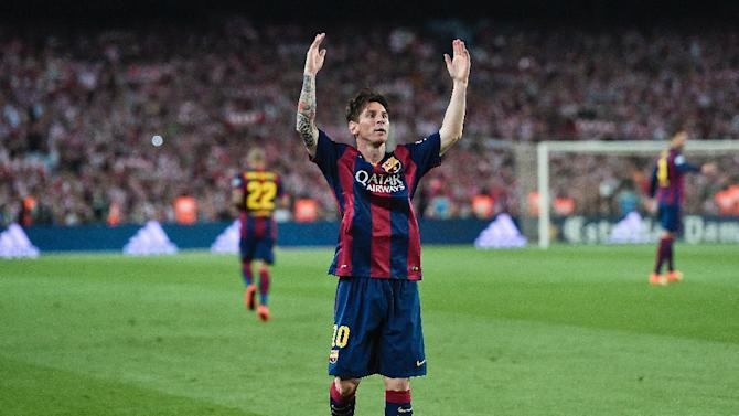 Barcelona's Argentinian forward Lionel Messi celebrates his goal during the Spanish Copa del Rey (King's Cup) final football match Athletic Club Bilbao vs FC Barcelona at the Camp Nou stadium in Barcelona on May 30, 2015