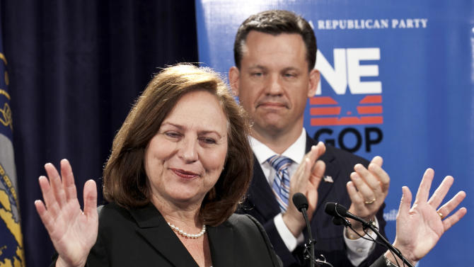 In this May 16, 2012, photo, Nebraska state Sen. Deb Fischer addresses supporters with her former opponent, state Attorney Gen. Jon Bruning applauding, right. For Senate Republicans, 2012 is starting a lot like 2010. Republicans have a shot at taking control of the Senate from Democrats as long as insurgent conservatives who are defeating the GOP's more establishment candidates in primaries don't frighten off independent voters like they did two years ago. Fischer, a little-known state senator, became the latest unexpected Senate Republican nominee Tuesday, rallying late to upset the favored _ and better funded _ choices of both the party's mainstream and tea party establishments. (AP Photo/Nati Harnik)