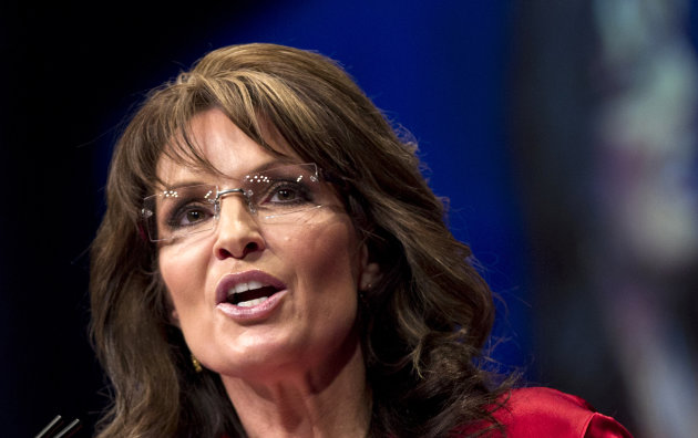 FILE - In this Feb. 11, 2012 file photo, Sarah Palin, the GOP candidate for vice-president in 2008, and former Alaska governor speaks in Washington. Sarah Palin and George W. Bush wont be in Tampa. Hillary Rodham Clinton and Al Gore arent making the trip to Charlotte. And scores of other Republican and Democratic stars are taking a pass as their parties gather at every-four-years national conventions. The reasons are varied _ and political. (AP Photo/J. Scott Applewhite)