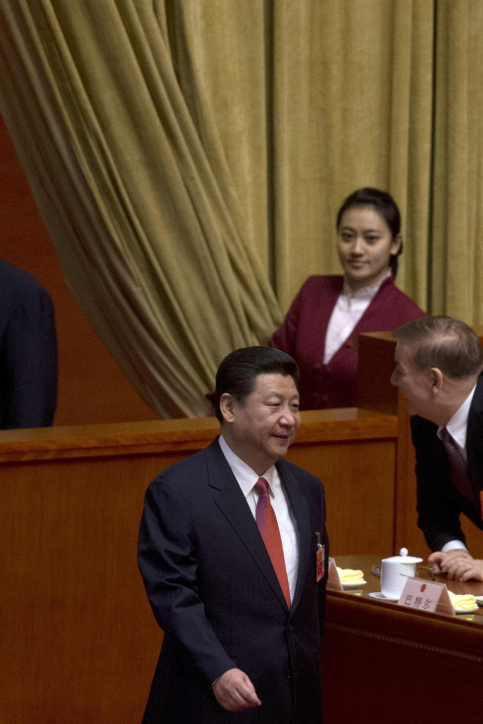 Chinese Communist Party chief and incoming-President Xi Jinping, arrives at a plenary session of the National People's Congress where delegates are expected to elect Xi officially as president at the Great Hall of the People in Beijing, China, Thursday, March 14, 2013. (AP Photo/Ng Han Guan)