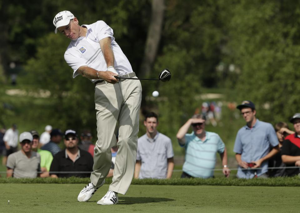 Jim Furyk hits his tee shot on the ninth hole during the second round of the PGA Championship golf tournament at Oak Hill Country Club, Friday, Aug. 9, 2013, in Pittsford, N.Y. (AP Photo/Charlie Riedel)
