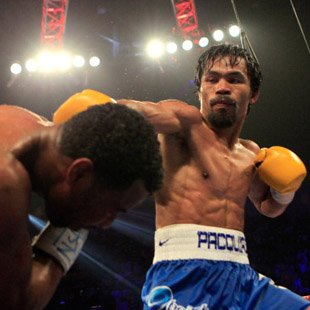 Manny Pacquiao lands a punch on Shane Mosley (Getty Images)