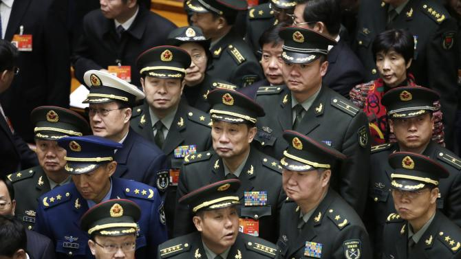 Military delegates wait to leave after the opening of the annual full session of the National People's Congress in Beijing