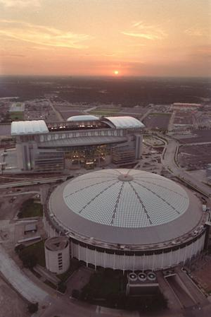 FILE - This Aug. 2, 2002, file photo, shows an aerial view of Reliant Stadium, top, the home of the Houston Texans, and the Astrodome, bottom, former home of the Houston Oilers in Houston. The Harris County Sports & Convention Corp. on Wednesday, June 19, 2013, recommended converting Houston's historic but deteriorating Astrodome into a giant convention center and exhibition space. The board's proposal would cost an estimated $194 million and take about 2 and a half years to complete. The plan now goes to Harris County commissioners, who will discuss it at a June 25 meeting. (AP Photo/Houston Chronicle, Smiley Pool)