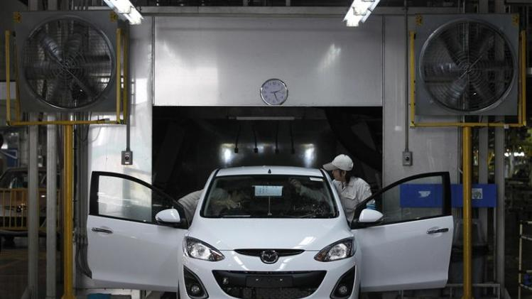 Employees work at an assembly line in AutoAlliance Thailand, a Ford and Mazda joint venture plant, located in Rayong province