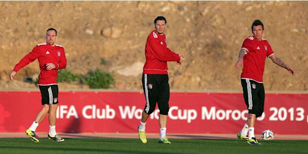Bayern's Franck Ribery of France, from left, Daniel van Buyten of Belgium and Mario Mandzukic of Croatia warm up at a last training session at the Club World Cup soccer tournament in Marrakech, Mo