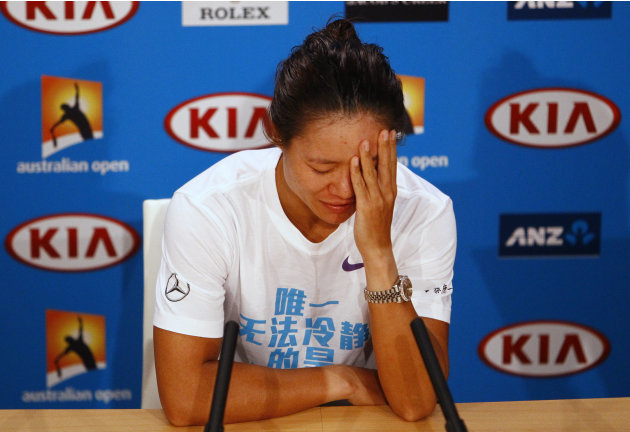 Li Na of China attends a news conference after being defeated by Victoria Azarenka of Belarus in their women's singles final match at the Australian Open tennis tournament in Melbourne