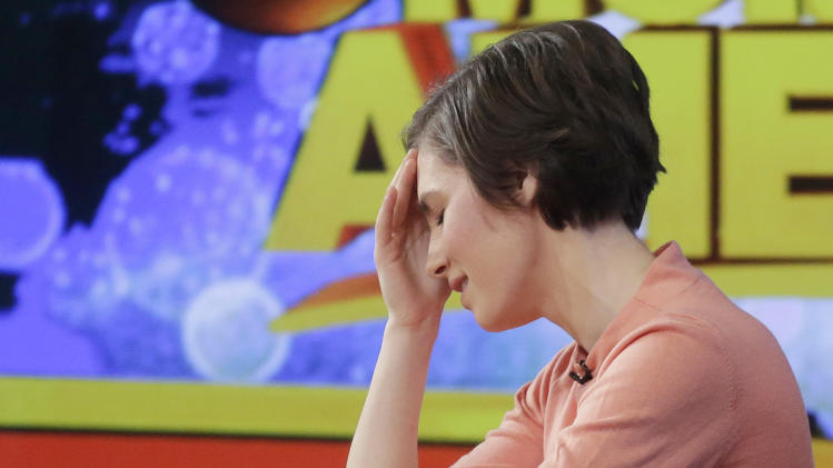 """Amanda Knox puts her hand to her forehead while making a television appearance, Friday, Jan. 31, 2014 in New York. Knox said she will fight the reinstated guilty verdict against her and an ex-boyfriend in the 2007 slaying of a British roommate in Italy and vowed to """"never go willingly"""" to face her fate in that country's judicial system . """"I'm going to fight this to the very end,"""" she said in an interview with Robin Roberts on ABC's """"Good Morning America."""" (AP Photo/Mark Lennihan)"""