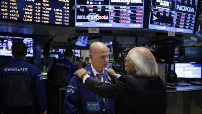 In this Wednesday, July 3, 2013, photo, traders work on the floor at the New York Stock Exchange in New York. Global stock markets posted modest gains Monday, July 15, 2013 registering relief that a slowdown in China's economic growth wasn't as sharp as feared. (AP Photo/Seth Wenig)