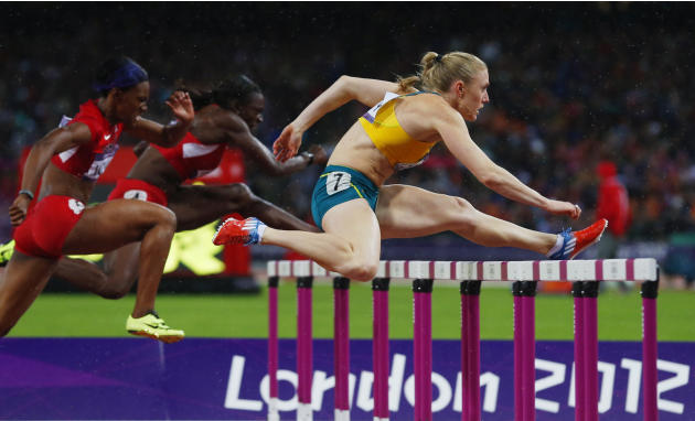Australia's Sally Pearson clears a hurdle ahead of Dawn Harper and Kellie Wells of the U.S. in the women's 100m hurdles final during the London 2012 Olympic Games at the Olympic Stadium