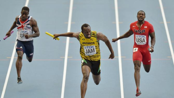 Jamaica's Usain Bolt, center, crosses the finish line to win ahead of United States' Justin Gatlin, right, and Britain's Dwayne Chambers in the men's 4x100-meter relay final at the World Athletics Championships in the Luzhniki stadium in Moscow, Russia, Sunday, Aug. 18, 2013. (AP Photo/Martin Meissner)