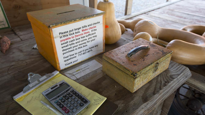 """Shown is the cash box at Dennis and Darlene Hess's farm stand Monday, Nov. 4, 2013, in Litiz, Pa. You can take our word for it: Americans don't trust each other anymore. An AP-GfK poll conducted last month found that Americans are suspicious of each other in everyday encounters. Less than a third expressed a lot of trust in clerks who swipe their credit cards, drivers on the road, or people they meet when traveling. However, there are still trusters around to set an example like Dennis Hess who runs an unattended farm stand on the honor system. Customers pick out their produce, tally their bills and drop the money into a slot, making change from an unlocked cashbox. """"When people from New York or New Jersey come up,"""" said Hess, """"they are amazed that this kind of thing is done anymore."""" (AP Photo/Matt Rourke)"""