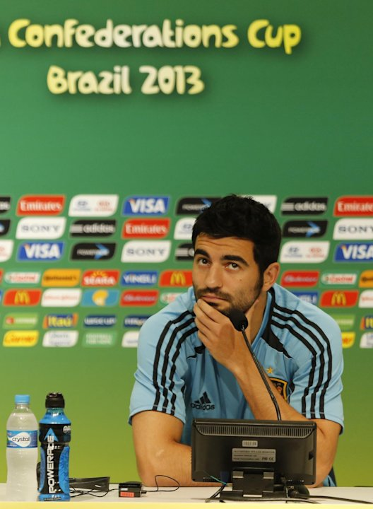 Spain's Raul Albiol listens to a question during a press conference one the day before Spain's group B match against Tahiti at the soccer Confederations Cup in Rio de Janeiro, Brazil, Wednesday, June