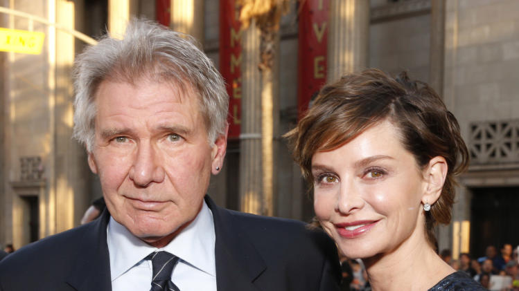 """Harrison Ford and Calista Flockhart arrive at the LA premiere of """"42"""" at the TCL Chinese Theater on Tuesday, April 9, 2013 in Los Angeles. (Photo by Todd Williamson/Invision/AP)"""