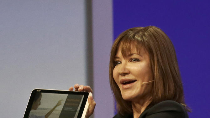 Microsoft corporate vice president for Windows Julie Larson-Green holds up a Acer Iconia W3 tablet while speaking at a Microsoft event in San Francisco, Wednesday, June 26, 2013. Microsoft is using a three-day conference this week to give people a peek into Windows 8.1, a free update that promises to address some of the gripes people have with the latest version of the company's flagship operating system. A preview version of Windows 8.1 was released Wednesday at the start of the Build conference for Microsoft partners and other technology developers. (AP Photo/Jeff Chiu)
