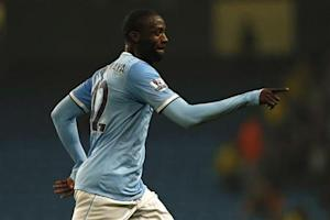 Manchester City's Toure celebrates after scoring during their English League Cup soccer match against Wigan Athletic at The Etihad Stadium in Manchester