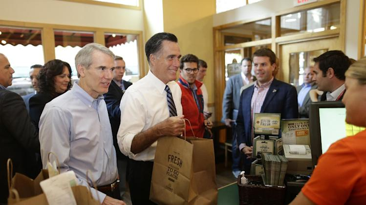 "Republican presidential candidate, former Massachusetts Gov. Mitt Romney, and Sen. Rob Portman, R-Ohio, left, make an unscheduled stop at First Watch cafe and picks up his ""to go"" order in Cincinnati, Ohio, Thursday, Oct. 25, 2012. (AP Photo/Charles Dharapak)"