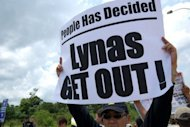Activists demonstrate against the Lynas Corporation on the road leading to the under construction Lynas plant in Gebeng, some 270 kilometres east of Kuala Lumpur in April 2012. A Malaysian court Wednesday ordered a further delay in the opening of a Lynas-owned rare earths plant, following protests from residents worried about possible radiation pollution