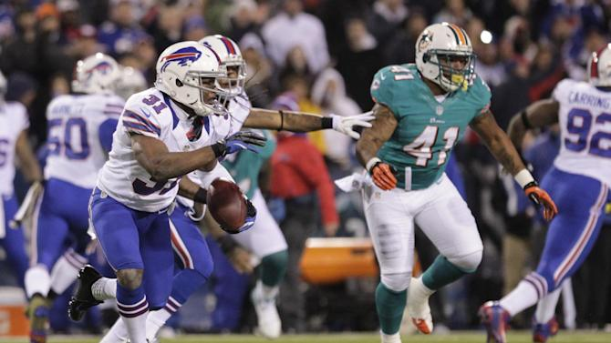 Buffalo Bills free safety Jairus Byrd (31) runs back a fumble recovery during the first half of an NFL football game against the Miami Dolphins, Thursday, Nov. 15, 2012, in Orchard Park, N.Y. (AP Photo/Bill Wippert)