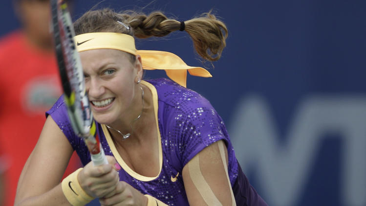 Petra Kvitova from the Czech Republic returns the ball to Slovakia's Daniela Hantuchova during the second day of the Dubai Duty Free Tennis Championships in Dubai, United Arab Emirates, Tuesday, Feb. 19, 2013. (AP Photo/Kamran Jebreili)