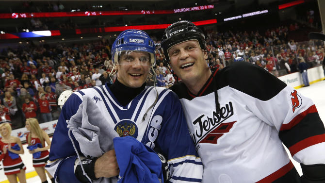 Russian Hockey Legend Alexey Yashin, left, poses with North American Hockey Legend Ken Daneyko after the Global Hockey Legends for Sandy Relief exhibition game at Prudential Center, Saturday, April 13, 2013, in Newark, N.J.  The team of Russian Hockey Legends defeated the team of North American Hockey Legends before a crowd of more than 6,000 spectators. (Photo by Jason DeCrow/Invision for KHL/AP Images)