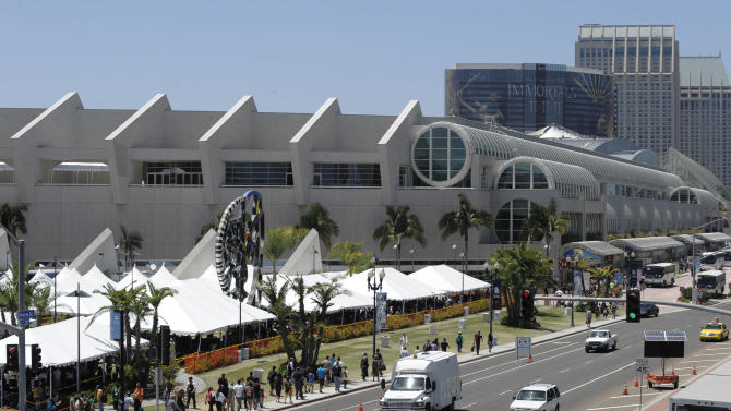 """FILE - In this July 22, 2011 file photo, fans are seen outside the San Diego Convention Center during the second day of the Comic-Con International 2011 convention held in San Diego. A Comic Con fan was fatally injured Tuesday, July 10, 2012 when she was hit by a car on her way to wait in line for a """"Twilight"""" panel at the San Diego Convention Center. (AP Photo/Denis Poroy, File)"""