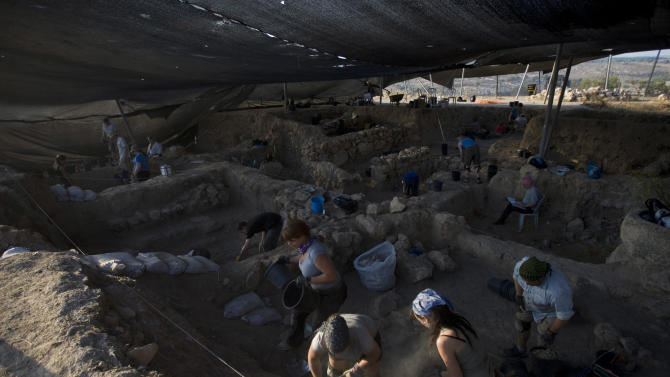 In this photo taken Wednesday, July 6, 2011, volunteers and archeologists work at the excavation site in Tel el-Safi, southern Israel. At the remains of an ancient metropolis in southern Israel, archaeologists are piecing together the history of a people remembered chiefly as the bad guys of the Hebrew Bible. The city of Gath, where this year's digging season began this week, is helping scholars paint a more nuanced portrait of the Philistines, who appear in the biblical story as the perennial enemies of the Israelites. (AP Photo/Ariel Schalit)