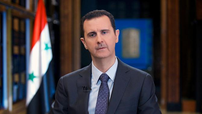 In this Wednesday, Sept. 25, 2013 photo released by the Syrian official news agency SANA, Syrian President Bashar Assad speaks during an interview with Venezuela's state-run Telesur network, in Damascus, Syria. Assad said in an interview broadcast Wednesday that he does not discount the possibility of a U.S. military attack even though threatened action was forestalled when he agreed to give up chemical weapons. (AP Photo/SANA)