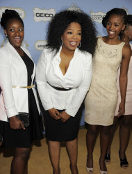 Honoree Oprah Winfrey poses with students from her Oprah Winfrey Leadership Academy for Girls in South Africa at the 6th Annual Black Women in Hollywood Luncheon at the Beverly Hills Hotel on Thursday, Feb. 21, 2013 in Los Angeles. (Photo by Chris Pizzello/Invision/AP)