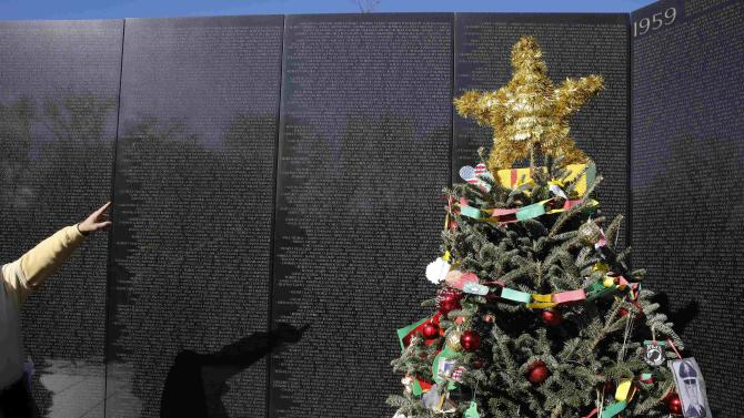 The star on the top of a Christmas tree decorated by volunteers is seen at the U.S. Vietnam Veterans Memorial in Washington