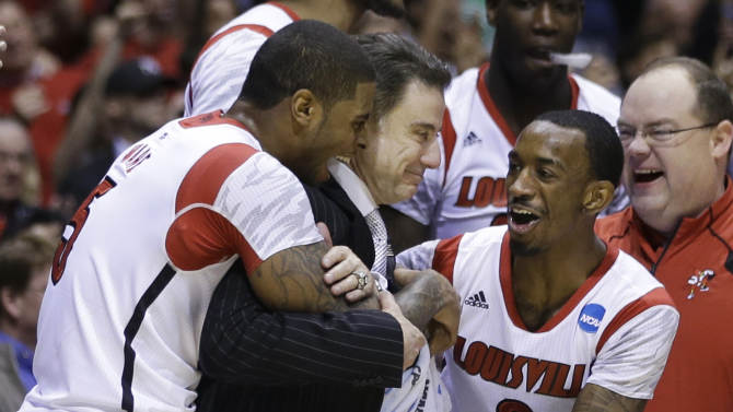 Louisville head coach Rick Pitino celebrates with Chane Behanan, left, and guard Russ Smith (2) after their 85-63 win over Duke in the Midwest Regional final in the NCAA college basketball tournament, Sunday, March 31, 2013, in Indianapolis. (AP Photo/Darron Cummings)