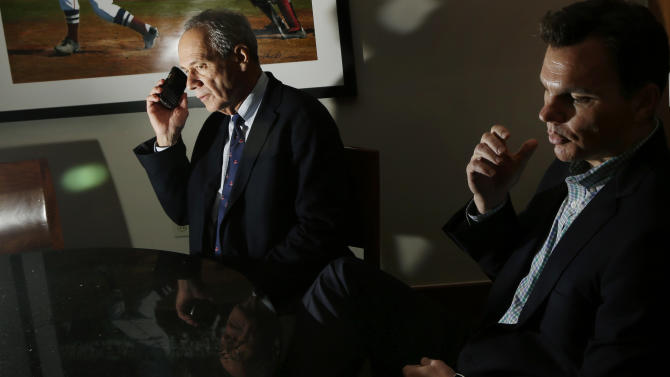 Boston Red Sox President and CEO Larry Lucchino. left, and general manager Ben Cherington appear during an interview at Fenway Park in Boston, Thursday, Oct. 4, 2012, hours after announcing that manager Bobby Valentine will not return in 2013. The Red Sox finished their baseball season in last place for the first time in 20 years. (AP Photo/Elise Amendola)