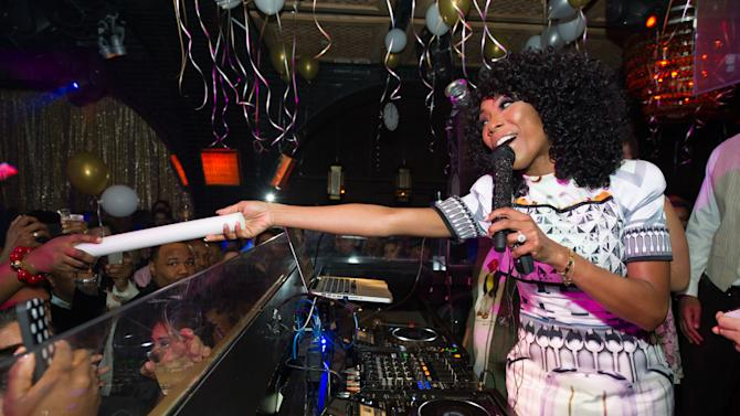 In this image released on Wednesday Jan. 2, 2013, R&B singer, Brandy performs at Lavo Nightclub on New Years Eve in Las Vegas. (Photo by Al Powers/Powers Imagery for TAO/Invision/AP)
