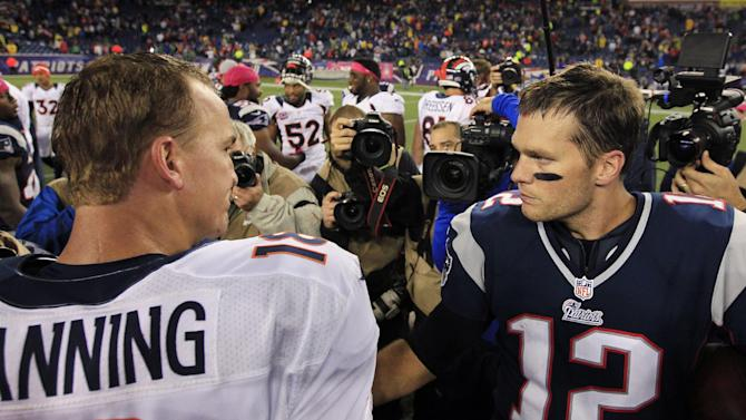 Denver Broncos quarterback Peyton Manning, left, and New England Patriots quarterback Tom Brady, right, meet after the Patriots' 31-21 win in their NFL football game, Sunday, Oct. 7, 2012, in Foxborough, Mass. (AP Photo/Steven Senne)