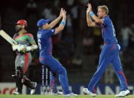"England captain Stuart Broad (R) celebrates with teammate Luke Wright (C) after he dismissed Afghan captain Nawroz Mangal (L) during their World Twenty20 on September 21. ""We will be fired up and wanting a win against India,"" Broad said"