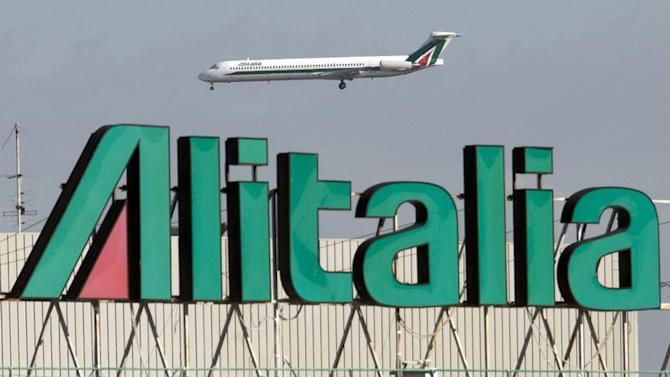 Alitalia jet makes a landing approach at Fiumicino airport in Rome