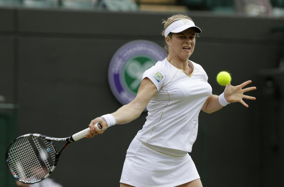 Kim Clijsters of Belgium returns a shot to Vera Zvonareva of Russia during a third round women's singles match at the All England Lawn Tennis Championships at Wimbledon, England, Friday, June 29, 2012. (AP Photo/Anja Niedringhaus)