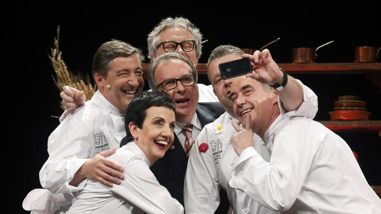 "Spanish chefs Roca, Ruscalleda, Adria, Chicote, Escriba and TV presenter Cuni take a 'selfie' during the ""La Fabrica del Menjar Solidari"" in Barcelona"