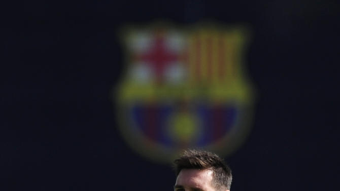 FC Barcelona's Lionel Messi, attends a training session at the Sports Center FC Barcelona Joan Gamper in San Joan Despi, Spain, Tuesday, Sept. 16, 2014. FC Barcelona will play against Apoel in a group F Champions League on Wednesday Sept. 17. (AP Photo/Manu Fernandez)
