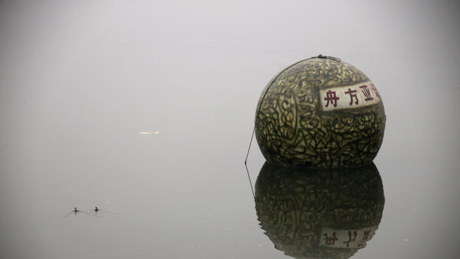 "A spherical pod, named ""Noah's Ark"", designed by Chinese inventor Liu Qiyuan floats on a river during a test in Xianghe"