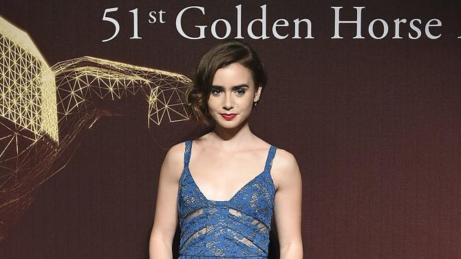 Actress Lily Collins poses for photographers on the red carpet at the 51st Golden Horse Film Awards in Taipei