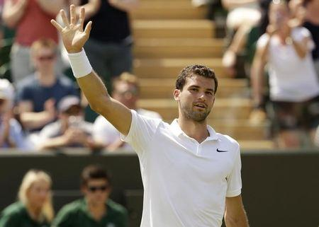 Grigor Dimitrov of Bulgaria celebrates after winning his match against Steve Johnson of the U.S.A. at the Wimbledon Tennis Championships in London