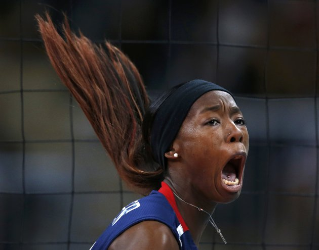 Hooker of the U.S. celebrates a point against Brazil during their women's gold medal volleyball match at Earls Court during the London 2012 Olympic Games