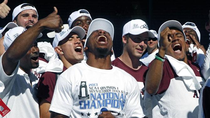 Texas A&M men's track team celebrates after tying with Florida to win the NCAA outdoor track and field championships in Eugene, Ore., Saturday, June 8, 2013. (AP Photo/Don Ryan)