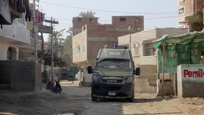 A police vehicle patrols at Dahshour village, about 40 kilometers (25 miles) south of Cairo,  Thursday, Aug. 2, 2012, a day after a sectarian violence erupted in the village  following the death of a Muslim man, prompting most the local Christians to flee, church and security officials said. (AP Photo/Amr Nabil)