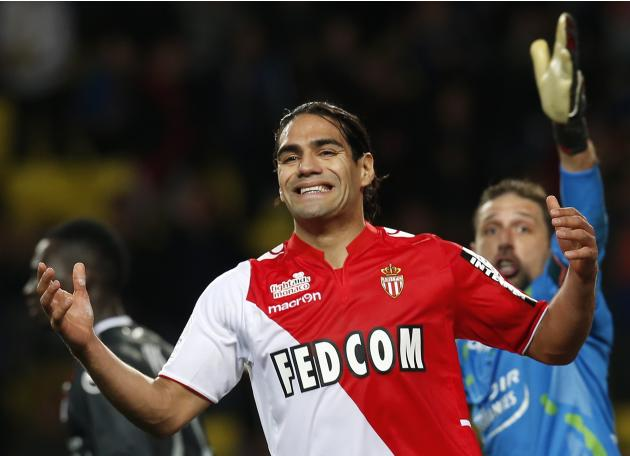 AS Monaco's Radamel Falcao reacts after missing a goal against Valenciennes' goalkeeper Nicolas Penneteau during their French Ligue 1 soccer match at Louis II stadium