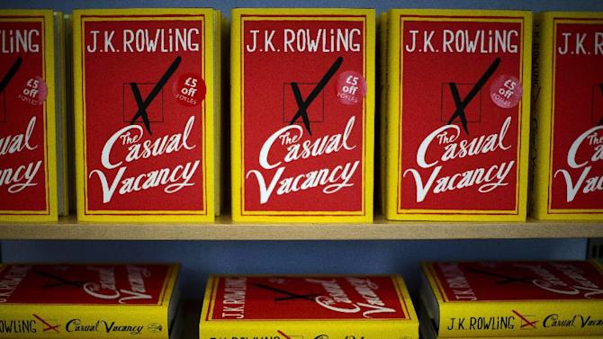 """Copies of the """"The Casual Vacancy"""" by author J.K. Rowling are displayed on shelves at a book store in London, Thursday, Sept. 27, 2012.  British bookshops are opening their doors early as Harry Potter author J.K. Rowling launches her long anticipated first book for adults.  Publishers have tried to keep details of the book under wraps ahead of its launch Thursday, but """"The Casual Vacancy"""" has gotten early buzz about references to sex and drugs that might be a tad mature for the youngest """"Potter"""" fans.  (AP Photo/Matt Dunham)"""